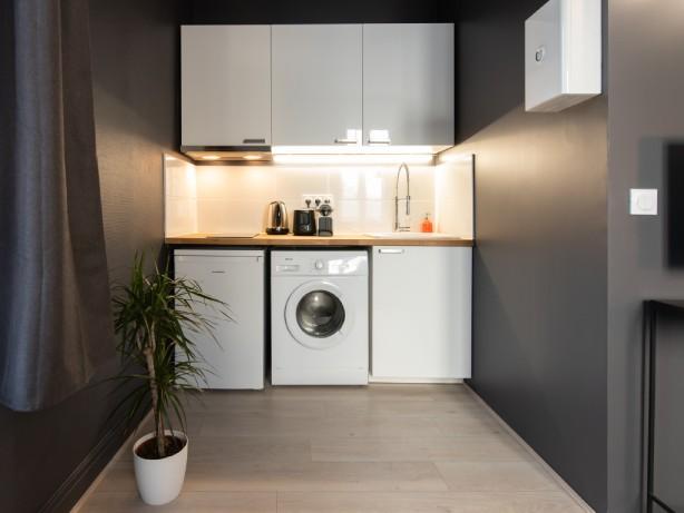 cuisine moderne équipée pour ce logement en location saisonnière sur Lyon 3ème